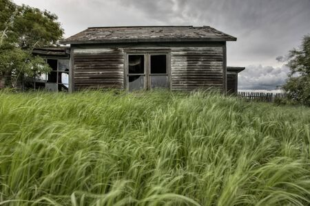 Abandoned Farm house with storm clouds