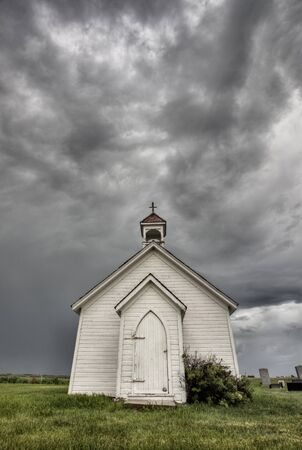 Old Country Church with storm clouds