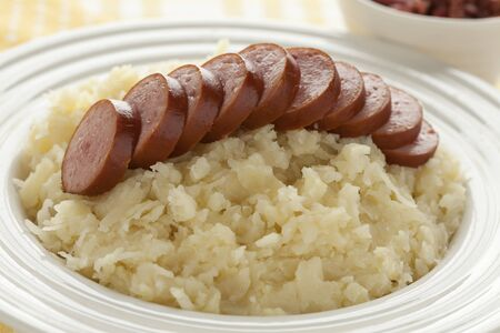 Traditional dutch meal with sauerkraut and sliced sausage