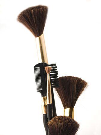 closeup of cosmetics brushes isolated on white background
