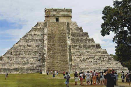 CHICHEN ITZA, MEXICO - DECEMBER 13TH; Pyramid of Chichen Itza, Mexico, among the new seven wonders of the world,  The four sides of 91 stairs are the origin of Mayan Calendar. one step for each day of the year, with the 365th day represented by the platfo