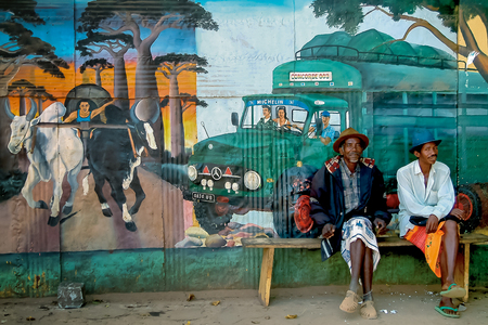 BELO SUR TSIRIBIHINA, MADAGASCAR, SEPT 15:  Unidentified elderly men sitting in front of a mural on sept 15, 2004 in Belo Tsiribihina, west of Madagascar