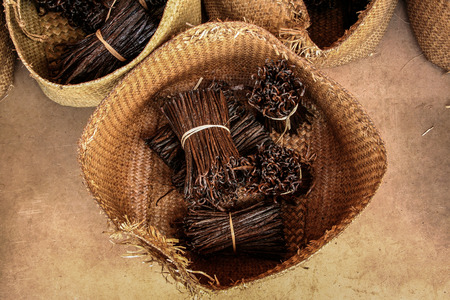 Photo for Bunches of Bourbon vanilla of Madagascar in craft baskets - Royalty Free Image