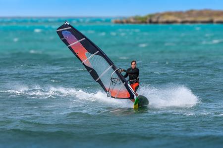 Foto für Men's windsurfer surfing in the lagoon - Lizenzfreies Bild