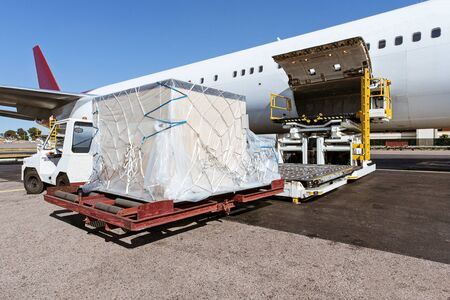Photo for Loading platform of freight to the aircraft - Royalty Free Image