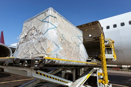 Photo for Goods are loaded on the airplane - Royalty Free Image