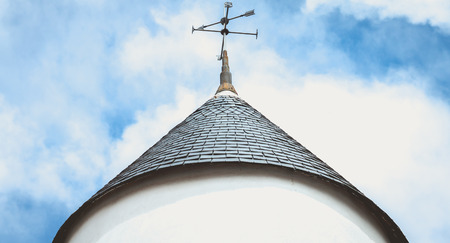Photo pour weather vane on the roof top of a windmill on the island of Noirmoutier, France - image libre de droit