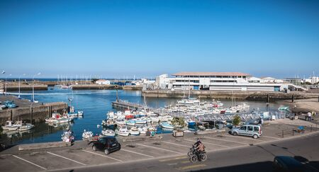 Port Joinville on the island of Yeu - September 17, 2018: view of the small port where maneuver fishing boats, tourism boats and sea shuttles going to the mainland on a summer day