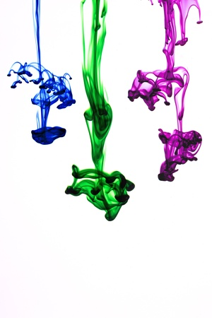 ink colors flowing in water  on white background