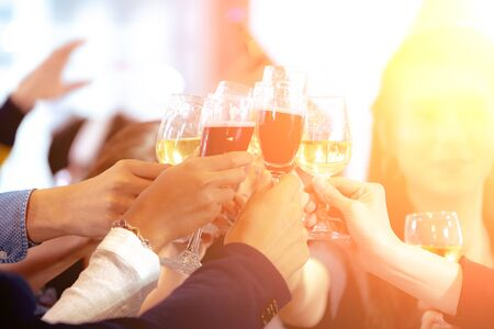 Photo pour Close up Clinking Glasses of Champagne or Wine. Group of Business People Celebrating New Year at Office party. Friends Happily Organized a celebration Party and Cheers Together at Workplace. - image libre de droit
