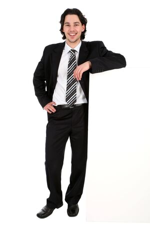 Photo pour Businessman leaning on a billboard - image libre de droit