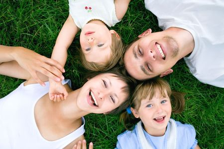 Photo for Family lying on grass - Royalty Free Image