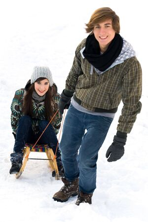 Man pulling woman on sled