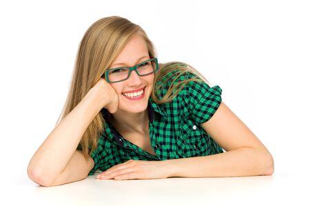 Photo pour Young woman leaning on table - image libre de droit