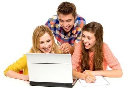 Photo pour Young people looking at laptop - image libre de droit