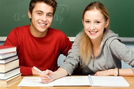Photo pour Students doing homework - image libre de droit