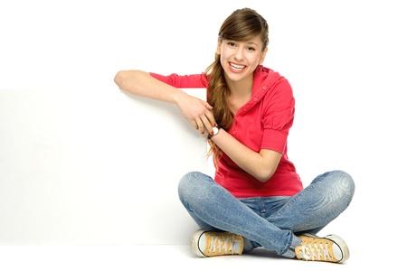 Photo pour Young woman leaning on blank poster - image libre de droit