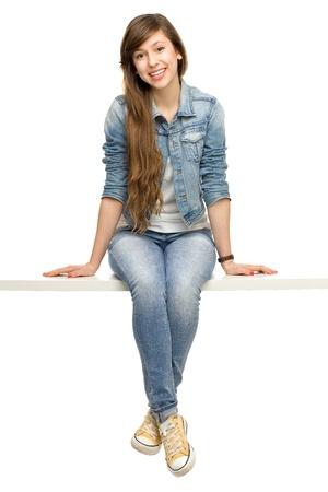 Photo pour Young woman sitting - image libre de droit