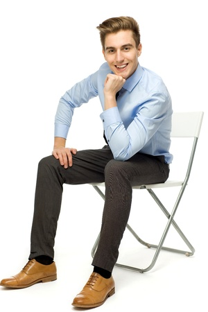 Photo for Handsome young man sitting  - Royalty Free Image