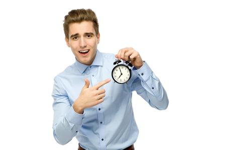 Man pointing at alarm clock
