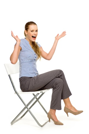 Photo for Attractive woman sitting on chair - Royalty Free Image