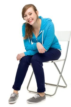 Female teenager sitting