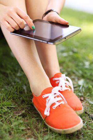 Photo for Girl using digital tablet  - Royalty Free Image