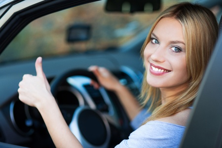 Woman in car giving thumbs up