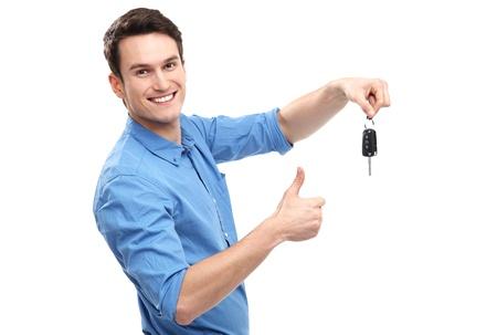 Photo pour Man with Car Keys and Thumbs Up - image libre de droit