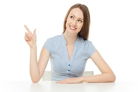 Photo pour Smiling woman pointing up - image libre de droit