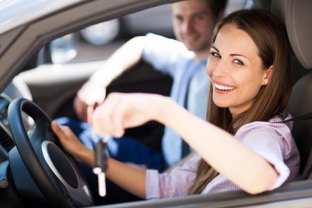 Young woman showing car keys
