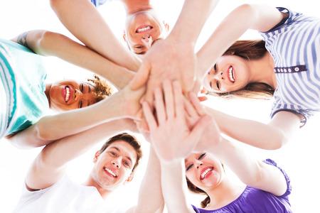 Photo pour Friends joining hands - image libre de droit