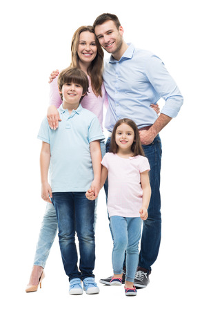 Photo pour Young family with two children standing together - image libre de droit