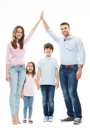 Photo pour Family forming shape of home - image libre de droit