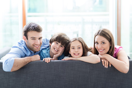 Family sitting on couchの写真素材