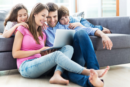 Family using a laptop at home