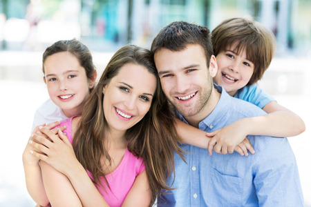 Photo pour Young family smiling - image libre de droit