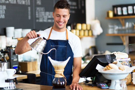 Barista pouring water into a coffee filter