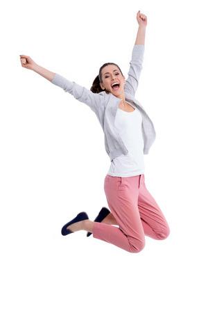 Photo pour Young woman jumping - image libre de droit