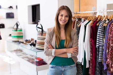 Foto de Sales assistant in clothing store - Imagen libre de derechos