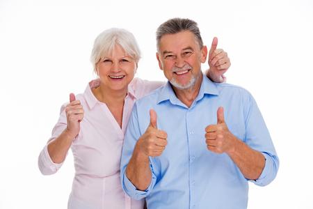 Photo pour Senior couple showing thumbs up - image libre de droit