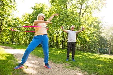 Photo pour Senior Couple Exercising In Park - image libre de droit