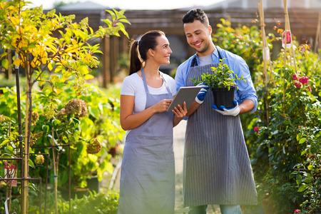Photo pour Smiling employees in garden center - image libre de droit