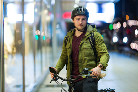 Young man on bicycle in the city