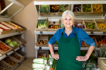 Photo for Senior woman working in small grocery store - Royalty Free Image