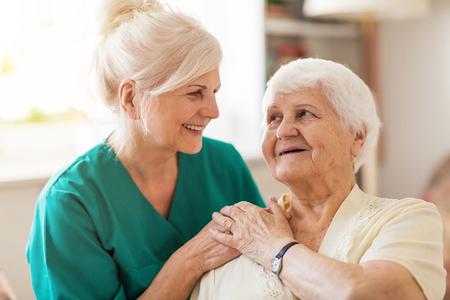 Photo pour Senior woman with her female caregiver - image libre de droit