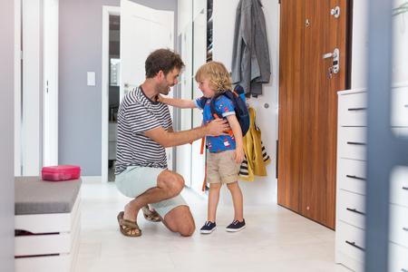 Photo pour Father helping son get ready for school - image libre de droit