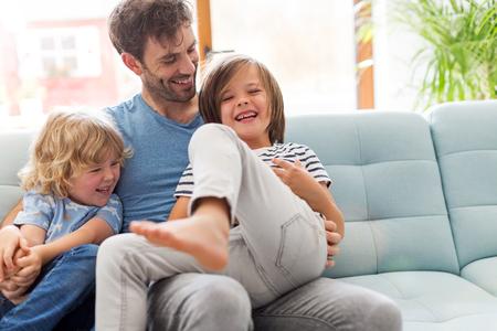 Foto für Father playing with his children at home - Lizenzfreies Bild