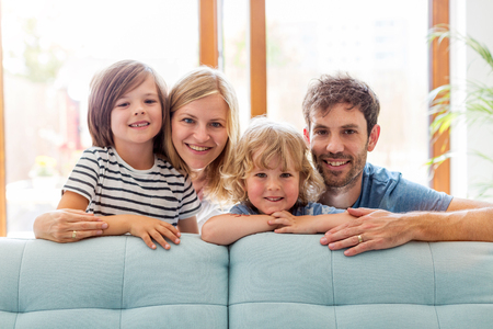 Photo for Happy young family with two children at home - Royalty Free Image