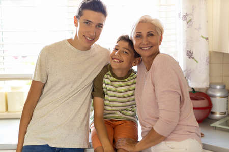 Photo for Happy mother with her two sons - Royalty Free Image